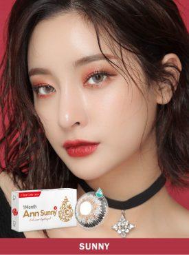 A Asian girl wears Ann365 Ann Sunny Gray contact lenses.
