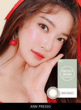 A Beautiful Asian girl wears Ann365 Ann Presso Brown colored contact lenses.