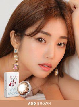 A Korean woman wears Ann365 Add Brown colored contact lens