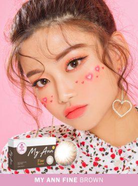 A Cute Asian girl wears Ann365 MY ANN Fine Brown colored contact lenses